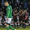 Team-mates congratulate Eoghan Stokes by  A Baldiemann